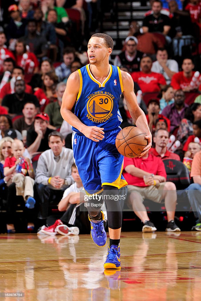 Stephen Curry #30 of the Golden State Warriors advances the ball against the Houston Rockets on March 17, 2013 at the Toyota Center in Houston, Texas.