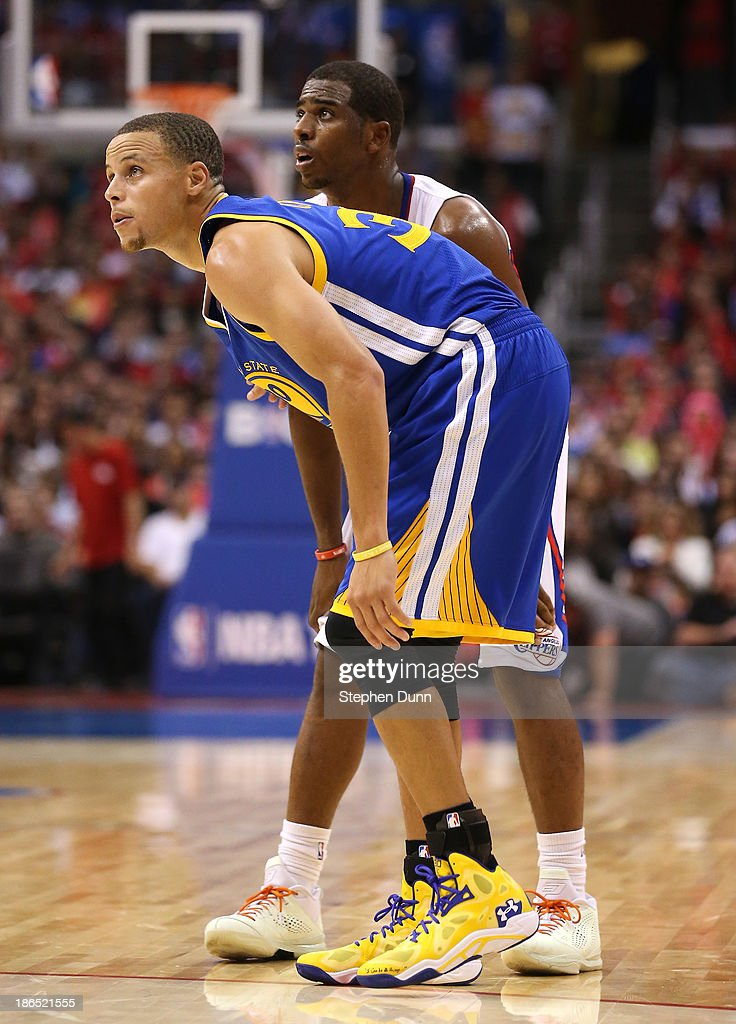 Stephen Curry #30 of the Golden State Warriors and <a gi-track='captionPersonalityLinkClicked' href=/galleries/search?phrase=Chris+Paul&family=editorial&specificpeople=212762 ng-click='$event.stopPropagation()'>Chris Paul</a> #3 of the Los Angeles Clippers set for play to begin at Staples Center on October 31, 2013 in Los Angeles, California. The Clippers won 126-115.
