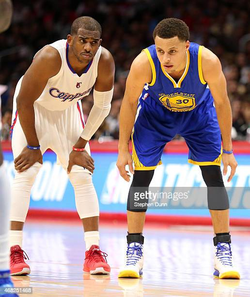 Stephen Curry of the Golden State Warriors and Chris Paul of the Los Angeles Clippers on the court during a foul shot at Staples Center on March 31...