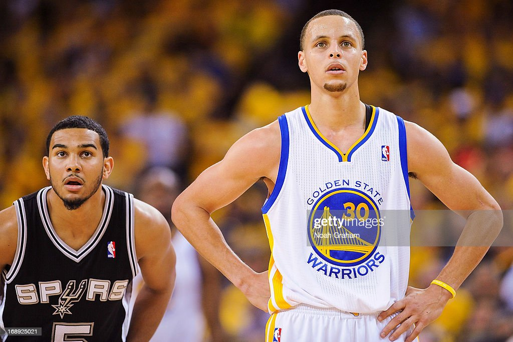 Stephen Curry #30 of the Golden State Warriors and Cory Joseph #5 of the San Antonio Spurs wait to resume play in Game Six of the Western Conference Semifinals during the 2013 NBA Playoffs on May 16, 2013 at Oracle Arena in Oakland, California.