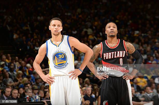 Stephen Curry of the Golden State Warriors and Damian Lillard of the Portland Trail Blazers during the game on April 3 2016 at Oracle Arena in...