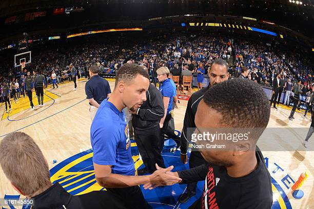 Stephen Curry of the Golden State Warriors and Damian Lillard of the Portland TrailBlazers on October 21 2016 at Oracle Arena in Oakland California...