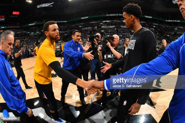 Stephen Curry of the Golden State Warriors and Dejounte Murray of the San Antonio Spurs meet before Game Four of the Western Conference Finals of the...