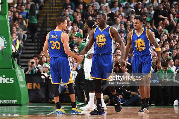 Stephen Curry of the Golden State Warriors and Draymond Green of the Golden State Warriors celebrate a play against the Boston Celtics on December 11...