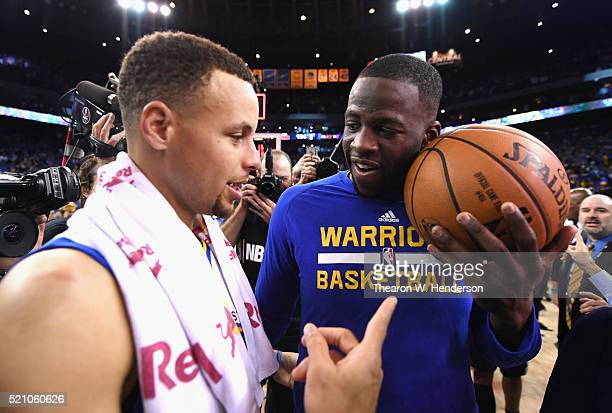 Stephen Curry of the Golden State Warriors and Draymond Green celebrate defeating the Memphis Grizzlies 125104 at ORACLE Arena on April 13 2016 in...