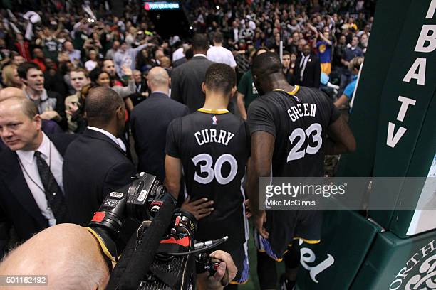 Stephen Curry of the Golden State Warriors and Draymond Green walk off the court after the 95108 loss to the Milwaukee Bucks at BMO Harris Bradley...