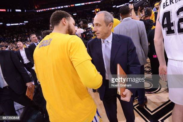 Stephen Curry of the Golden State Warriors and Ettore Messina of the San Antonio Spurs greet each other on the court after Game Four of the Western...