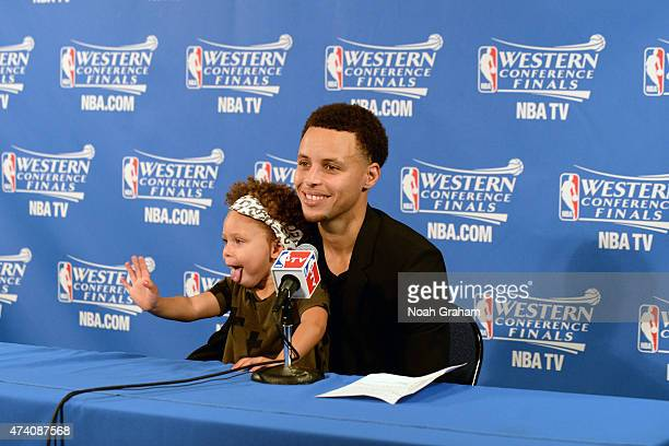 Stephen Curry of the Golden State Warriors and his daughter Riley adressing the media at a press conference after the game against the Houston...