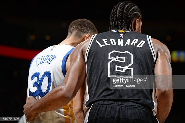 Stephen Curry of the Golden State Warriors and Kawhi Leonard of the San Antonio Spurs stand on the court during the game on April 7 2016 at ORACLE...
