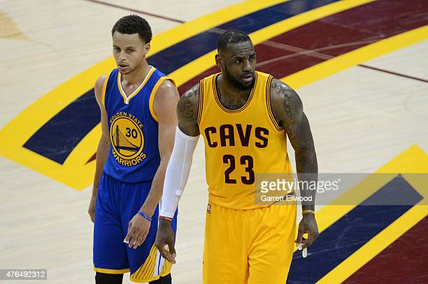 Stephen Curry of the Golden State Warriors and LeBron James of the Cleveland Cavaliers look on in Game Three of the 2015 NBA Finals on June 9 2015 at...
