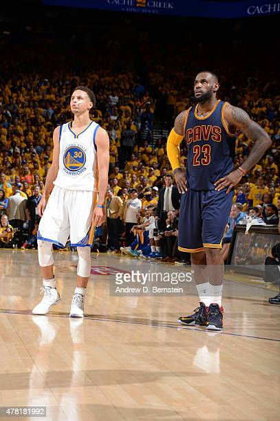 Stephen Curry of the Golden State Warriors and LeBron James of the Cleveland Cavaliers stand on the court during Game Five of the 2015 NBA Finals at...