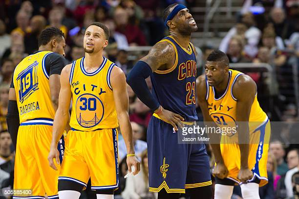 Stephen Curry of the Golden State Warriors and LeBron James of the Cleveland Cavaliers react during the first half at Quicken Loans Arena on January...