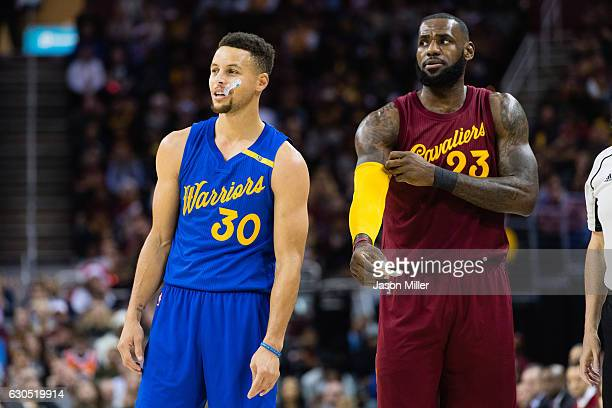 Stephen Curry of the Golden State Warriors and LeBron James of the Cleveland Cavaliers pause on the court during the first half at Quicken Loans...