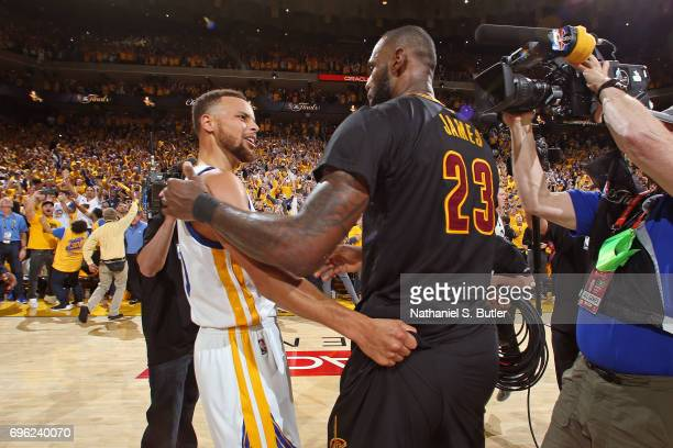 Stephen Curry of the Golden State Warriors and LeBron James of the Cleveland Cavaliers talk after Game Five of the 2017 NBA Finals on June 12 2017 at...