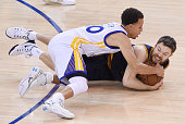 Stephen Curry of the Golden State Warriors and Matthew Dellavedova of the Cleveland Cavaliers vie for posession in the first quarter during Game Five...