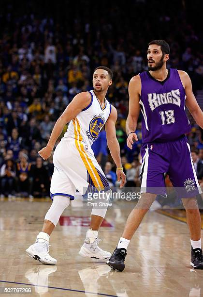 Stephen Curry of the Golden State Warriors and Omri Casspi of the Sacramento Kings watch a threepoint basket by Curry go in to the basket at ORACLE...