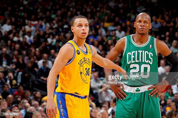 Stephen Curry of the Golden State Warriors and Ray Allen of the Boston Celtics stand on the court during the game on February 22 2011 at Oracle Arena...