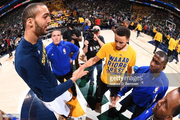 Stephen Curry of the Golden State Warriors and Rudy Gobert of the Utah Jazz meet at mid court before Game Four of the Western Conference Semifinals...