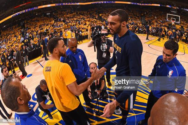 Stephen Curry of the Golden State Warriors and Rudy Gobert of the Utah Jazz shake hands before Game Two the Western Conference Semifinals during the...
