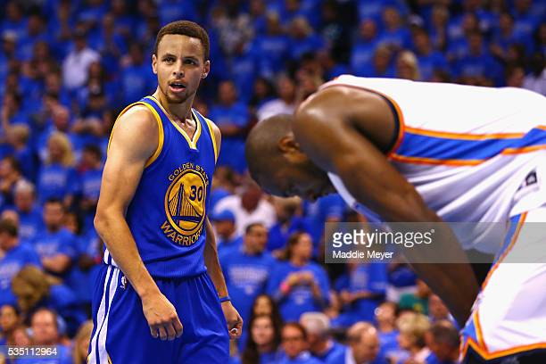 Stephen Curry of the Golden State Warriors and Serge Ibaka of the Oklahoma City Thunder react during the fourth quarter in game six of the Western...