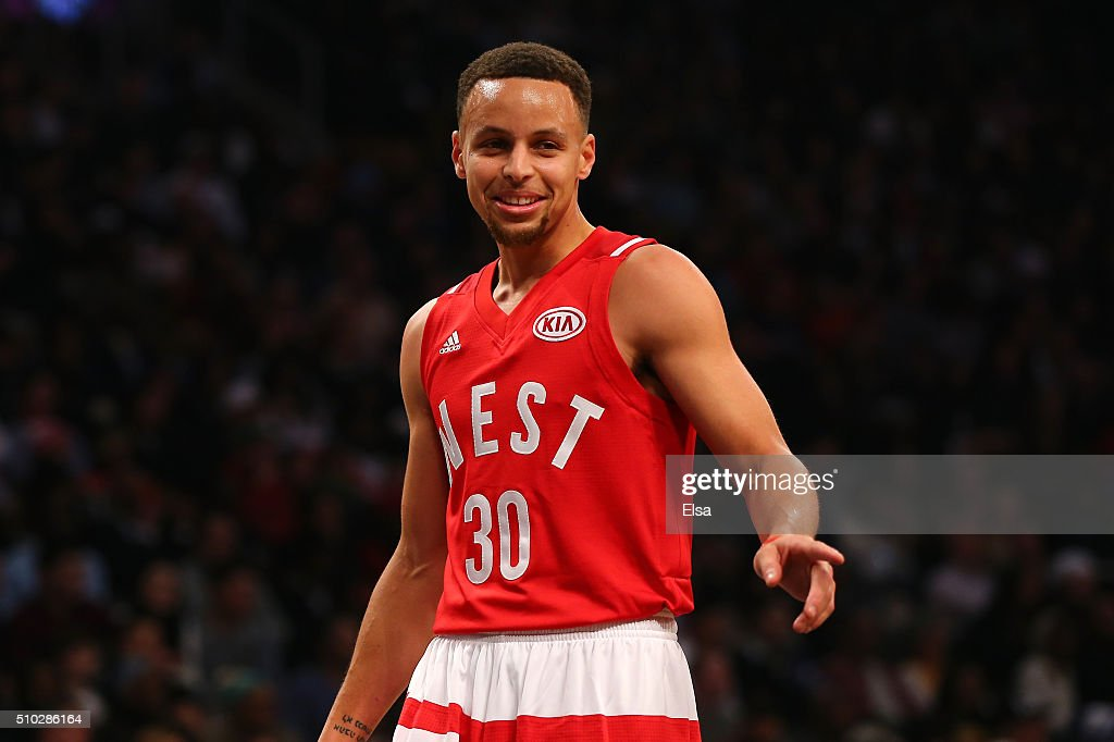 Stephen Curry of the Golden State Warriors and the Western Conference gestures after a play in the first quarter against the Eastern Conference...