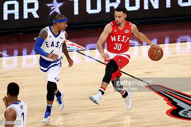 Stephen Curry of the Golden State Warriors and the Western Conference handles the ball against Isaiah Thomas of the Boston Celtics and the Eastern...