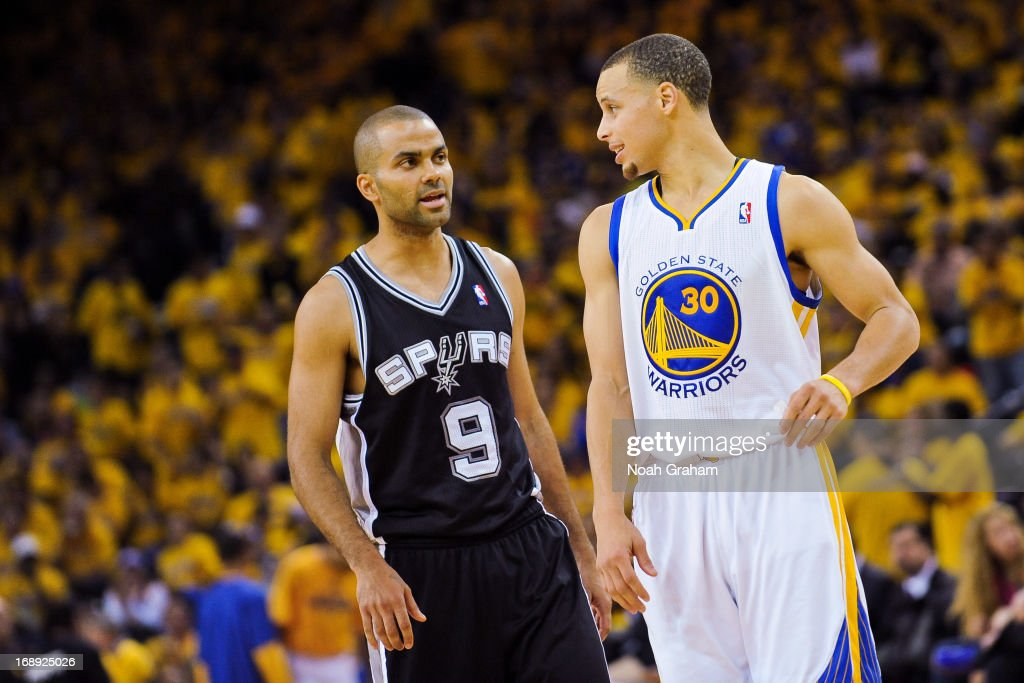 Stephen Curry #30 of the Golden State Warriors and Tony Parker #9 of the San Antonio Spurs speak in Game Six of the Western Conference Semifinals during the 2013 NBA Playoffs on May 16, 2013 at Oracle Arena in Oakland, California.