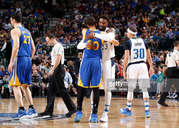 Stephen Curry of the Golden State Warriors and Wesley Matthews of the Dallas Mavericks hug before the game on March 21 2017 at the American Airlines...