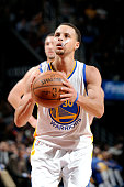 Stephen Curry of the Golden State Warriors attempts a free throw against the Cleveland Cavaliers at The Quicken Loans Arena on February 26 2015 in...