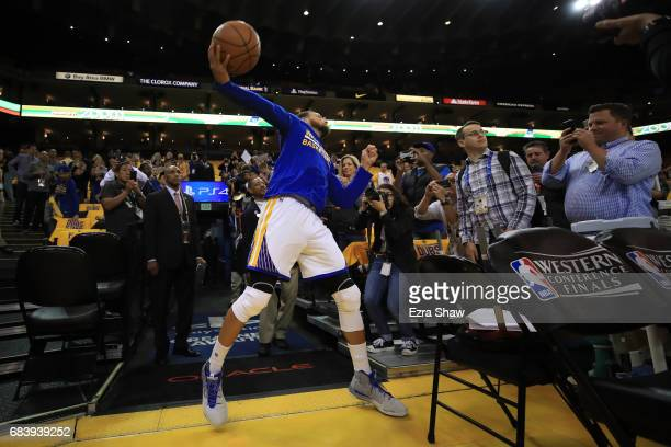 Stephen Curry of the Golden State Warriors attempts a full court shot from the tunnel during warms up prior to Game Two of the NBA Western Conference...