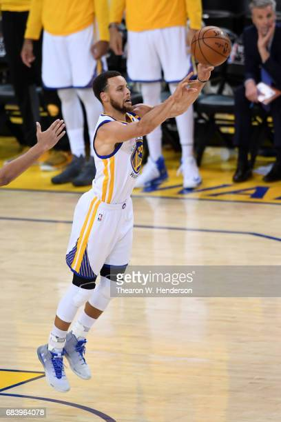 Stephen Curry of the Golden State Warriors attempts a last second shot at the end of the first half against the San Antonio Spurs during Game Two of...