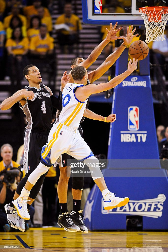 Stephen Curry #30 of the Golden State Warriors attempts a layup against Tim Duncan #21 of the San Antonio Spurs in Game Six of the Western Conference Semifinals during the 2013 NBA Playoffs on May 16, 2013 at Oracle Arena in Oakland, California.