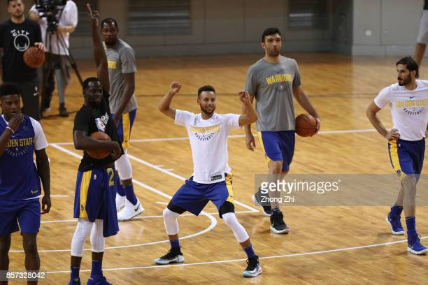 Stephen Curry of the Golden State Warriors attempts a long distance 3 pointer during practice with Draymond Green and Kevin Durant and team mates...