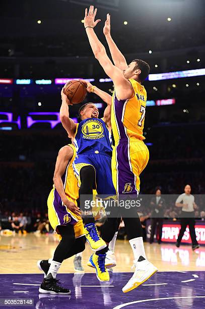 Stephen Curry of the Golden State Warriors attempts a shot in front of Larry Nance Jr #7 of the Los Angeles Lakers during the first half at Staples...