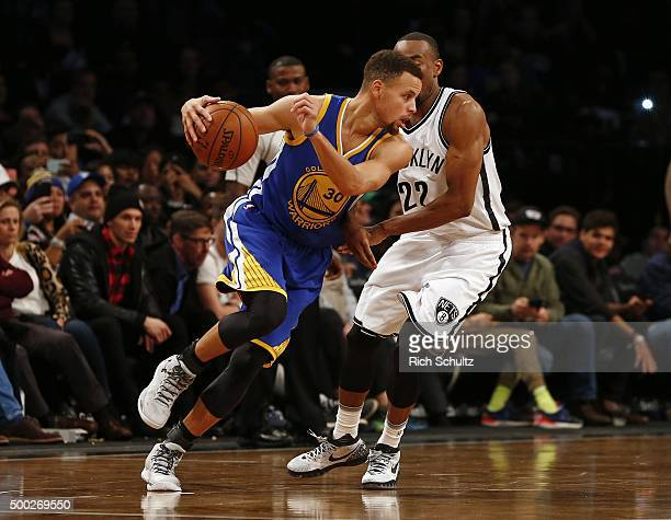 Stephen Curry of the Golden State Warriors attempts to get past Markel Brown of the Brooklyn Nets during the fourth quarter in an NBA basketball game...