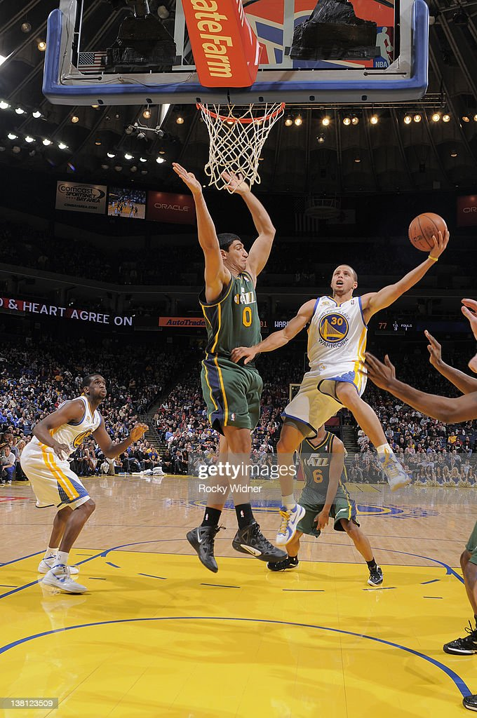 Stephen Curry #30 of the Golden State Warriors attempts to lay the ball up around <a gi-track='captionPersonalityLinkClicked' href=/galleries/search?phrase=Enes+Kanter&family=editorial&specificpeople=5621416 ng-click='$event.stopPropagation()'>Enes Kanter</a> #0 of the Utah Jazz on February 2, 2012 at Oracle Arena in Oakland, California.