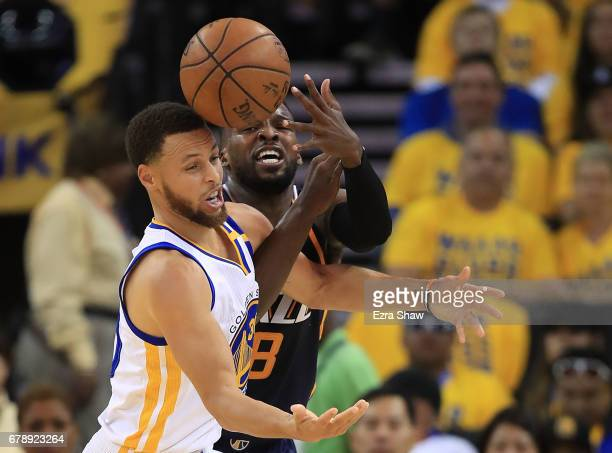Stephen Curry of the Golden State Warriors battles for the ball against Shelvin Mack of the Utah Jazz during Game Two of the NBA Western Conference...