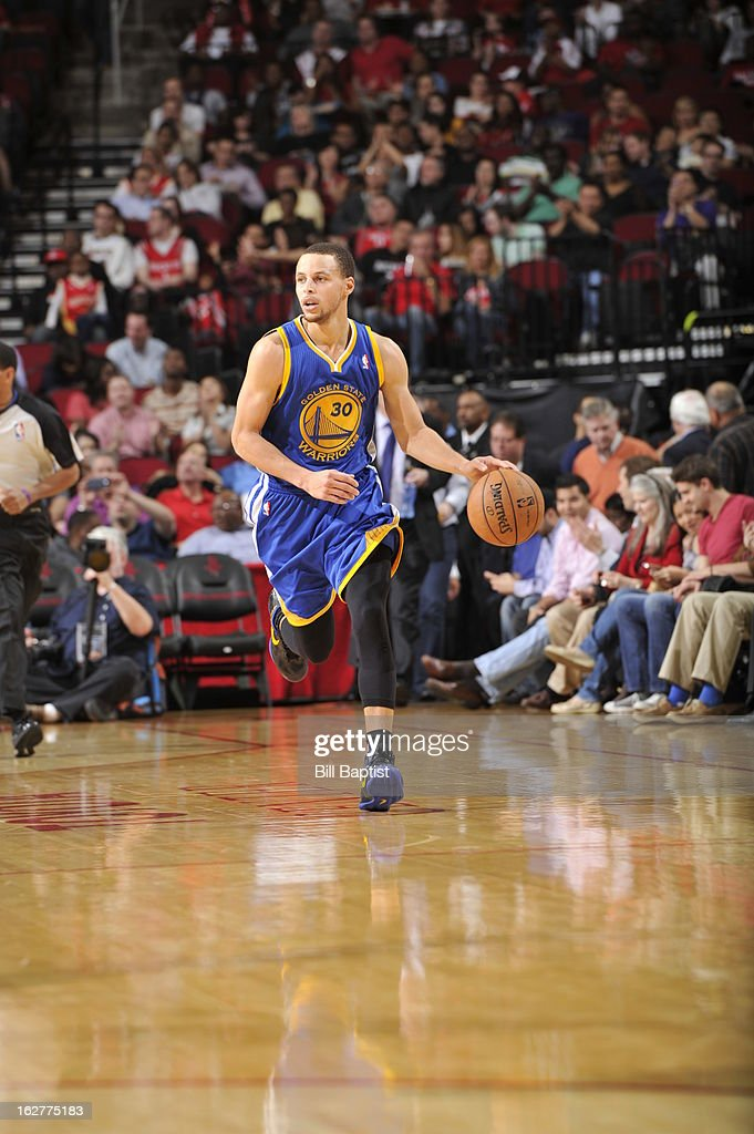 Stephen Curry #30 of the Golden State Warriors brings the ball up court against the Houston Rockets on February 5, 2013 at the Toyota Center in Houston, Texas.