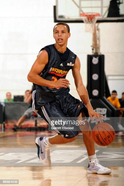 Stephen Curry of the Golden State Warriors brings the ball up court against the Sacramento Kings during NBA Summer League presented by EA Sports on...