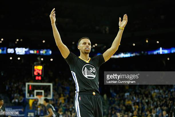 Stephen Curry of the Golden State Warriors celebrates a basket against the Phoenix Suns at ORACLE Arena on March 12 2016 in Oakland California NOTE...