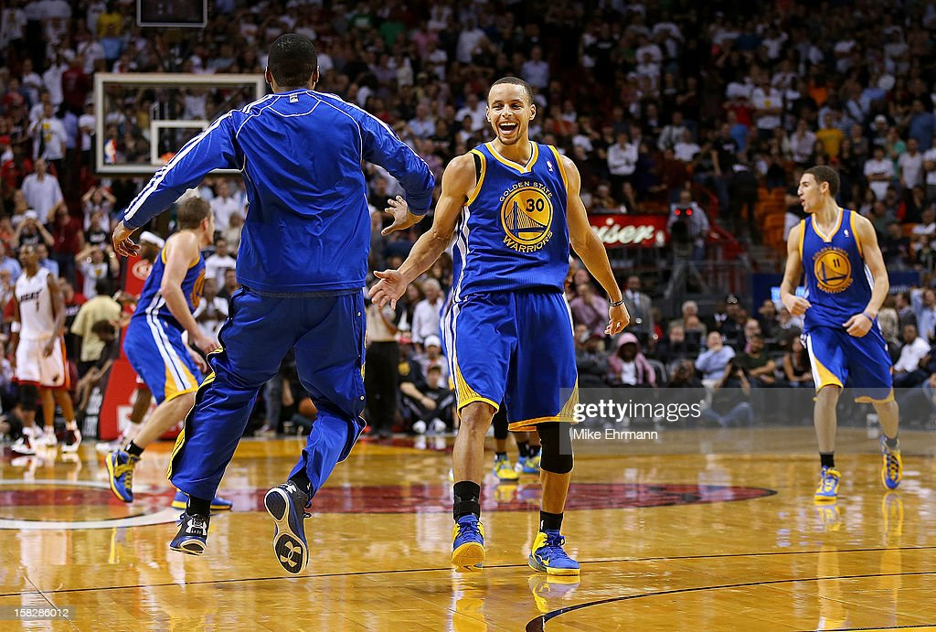 Stephen Curry #30 of the Golden State Warriors celebrates a last second shot during a game against the Miami Heat at American Airlines Arena on December 12, 2012 in Miami, Florida.