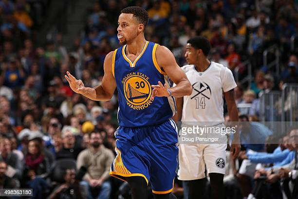 Stephen Curry of the Golden State Warriors celebrates a three point basket against the Denver Nuggets at Pepsi Center on November 22 2015 in Denver...