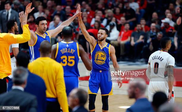 Stephen Curry of the Golden State Warriors celebrates a three point shot with Zaza Pachulia against the Portland Trail Blazers during Game Four of...