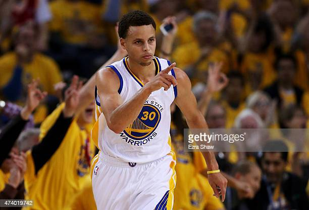 Stephen Curry of the Golden State Warriors celebrates a three pointer in the first half against the Houston Rockets during Game One of the Western...