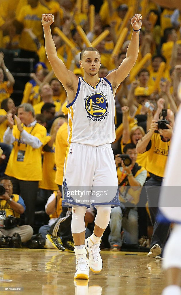 Stephen Curry #30 of the Golden State Warriors celebrates after defeating the Denver Nuggets during Game Six of the Western Conference Quarterfinals of the 2013 NBA Playoffs at ORACLE Arena on May 2, 2013 in Oakland, California.
