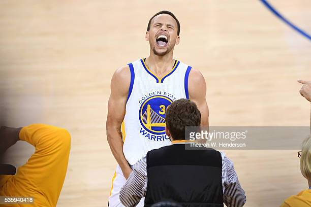 Stephen Curry of the Golden State Warriors celebrates after defeating the Oklahoma City Thunder 9688 in Game Seven of the Western Conference Finals...