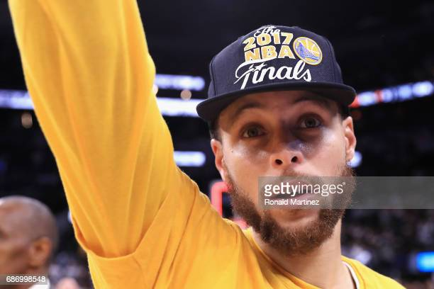 Stephen Curry of the Golden State Warriors celebrates after defeating the San Antonio Spurs 129115 in Game Four of the 2017 NBA Western Conference...