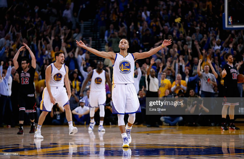 Stephen Curry of the Golden State Warriors celebrates after Harrison Barnes made a threepoint basket late in the fourth quarter of their game against...