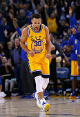 Stephen Curry of the Golden State Warriors celebrates after he made a threepoint basket against the Toronto Raptors at ORACLE Arena on November 17...