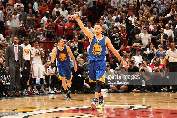 Stephen Curry of the Golden State Warriors celebrates after hitting a three point shot against the Miami Heat on February 24 2016 at American...